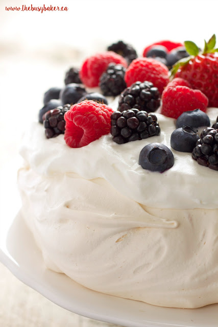 The Perfect Pavlova recipe makes a delicious and showstopping easy-to-make gluten-free dessert that's also on the healthier side! Recipe from thebusybaker.ca!