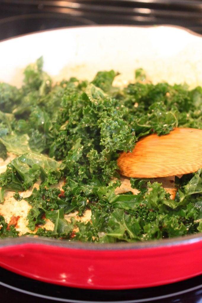 sauteing fresh kale in a pan