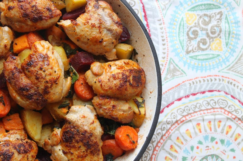 pan of paprika chicken thighs with roasted vegetables and kale