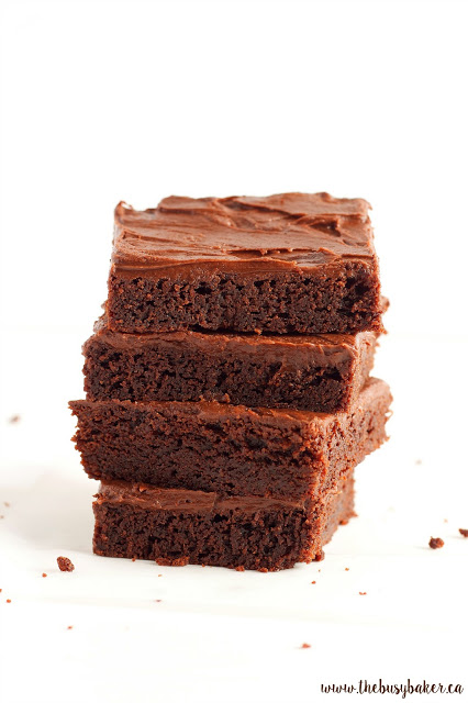 stack of fudge brownies with chocolate frosting