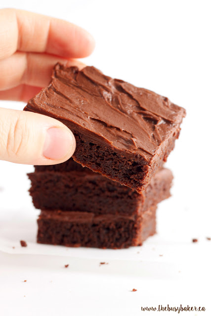 removing a fudgy brownie from the top of a stack