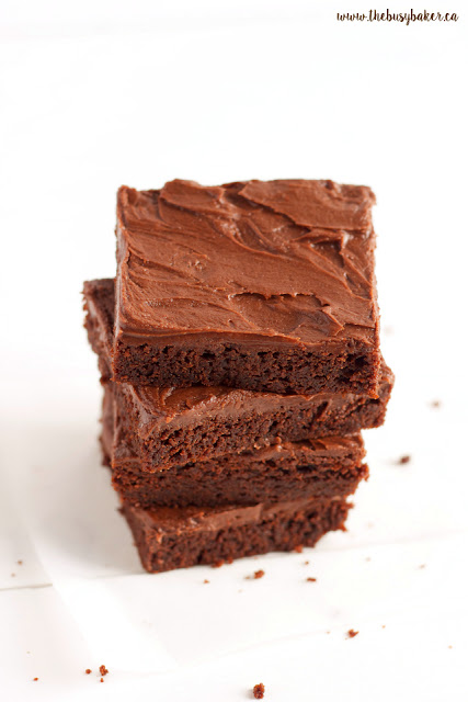 stack of frosted fudge brownies