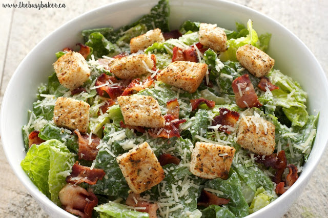This Greek Yogurt Caesar Salad is a healthy and low fat alternative to traditional Caesar salad! It's ultra creamy and delicious and it's so easy to make! Recipe from thebusybaker.ca!