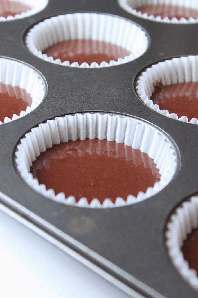 cupcake batter in a muffin tin