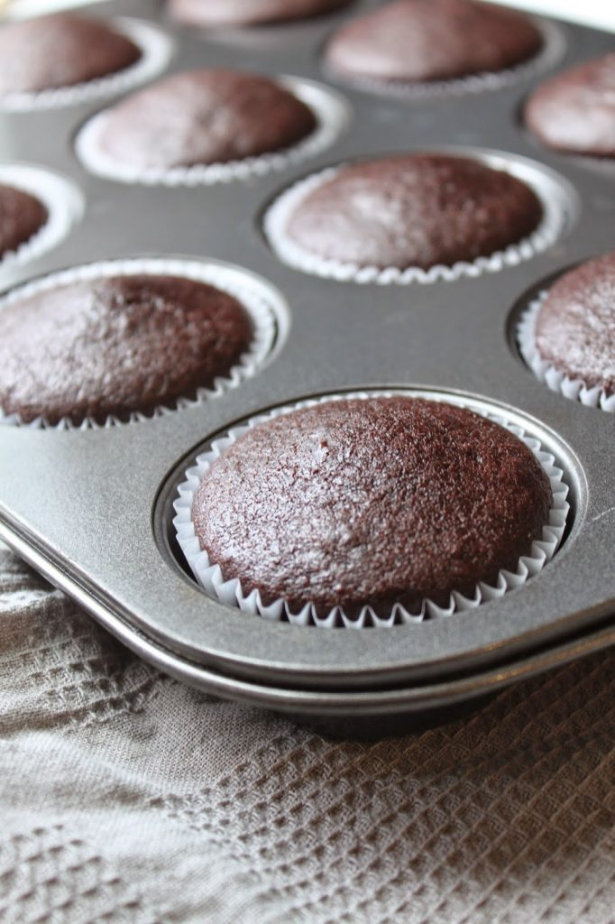 fluffy chocolate cupcakes in a muffin tin