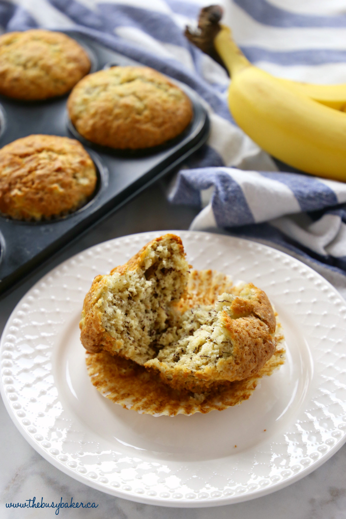 These Best Ever Banana Muffins are the best banana muffins you'll ever try - crispy on the outside and fluffy on the inside! And so easy to make in only one bowl! Ready in minutes! Recipe from thebusybaker.ca! #besteverbananamuffins #bestbananamuffins #bananamuffins #easymuffinrecipe