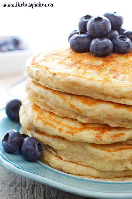 stack of homemade buttermilk pancakes topped with blueberries
