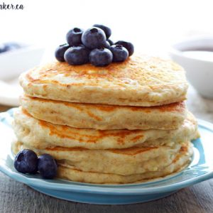 stack of healthy buttermilk pancakes with fresh blueberries