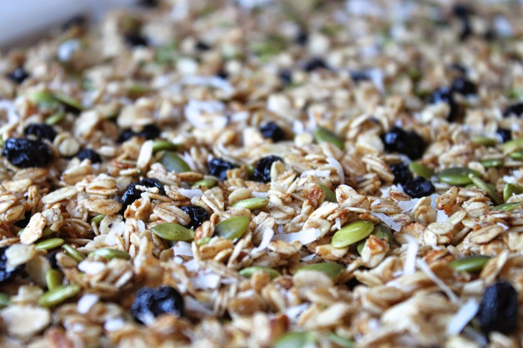 baking sheet with homemade blueberry granola with pumpkin seeds