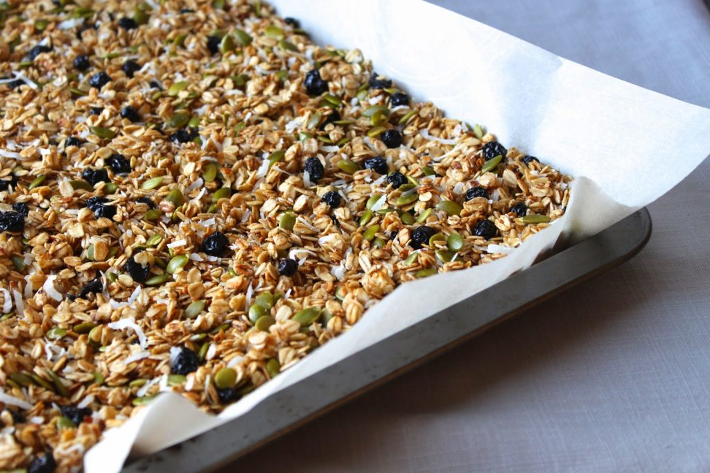 healthy homemade granola on a baking pan