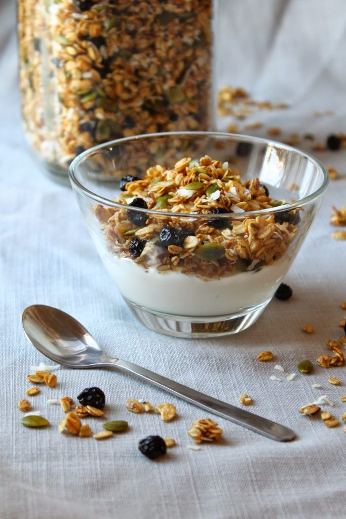 cereal bowl filled with homemade granola and milk