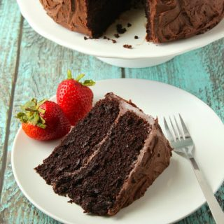 slice of chocolate layer cake on a plate