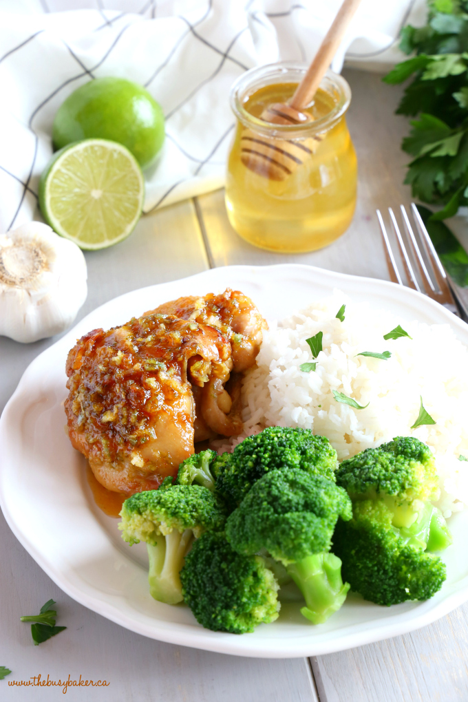This Honey Garlic Lime Chicken is an easy weeknight meal recipe featuring tender chicken thighs cooked in a sweet lime and garlic sauce! Just a few simple ingredients and you're on your way to a delicious family meal that's so easy to make! Recipe from thebusybaker.ca! #easyhoneygarlicchicken #easychickenrecipe #honeygarlicsauce