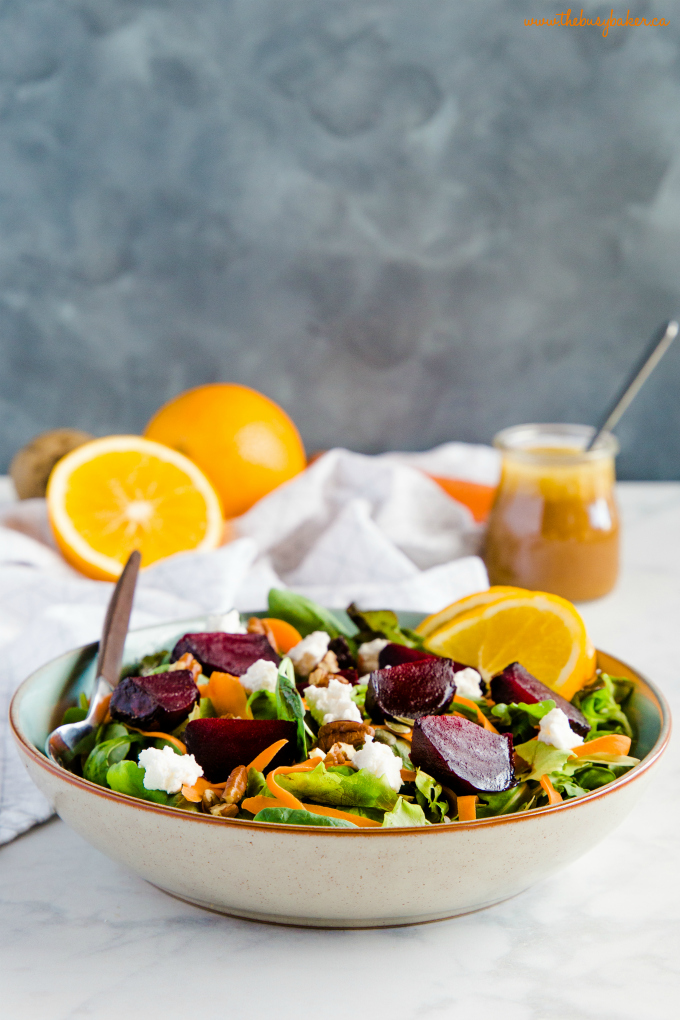 a bowl of salad with roasted beets and goat cheese