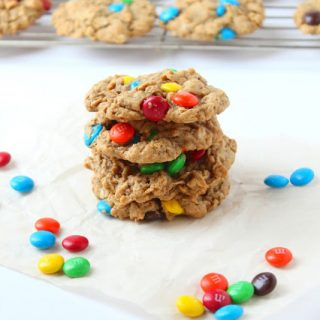 a stack of Monster Cookies surrounded by M&Ms candies