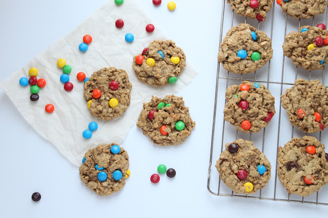 peanut butter oatmeal cookies with M&M's on a cooling rack