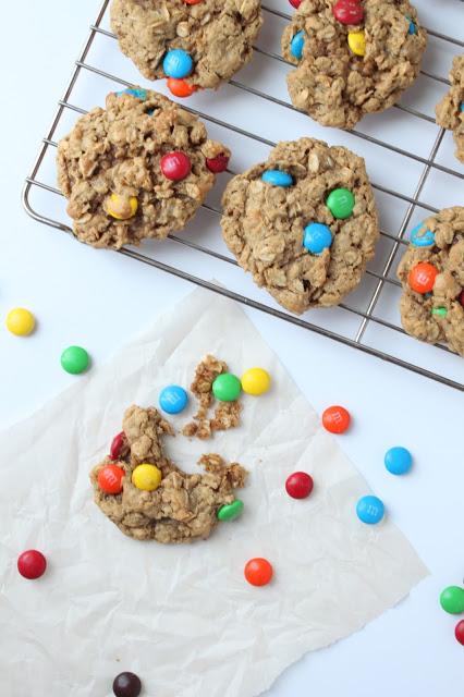 peanut butter oatmeal M&M cookies on a cooling rack