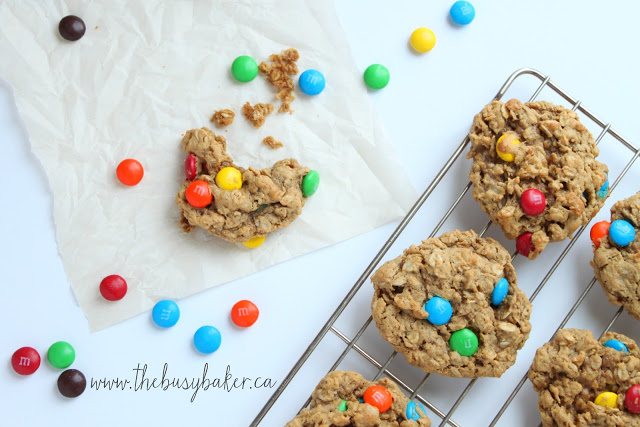M&M's surrounding a Monster Cookie with a bite taken out of it