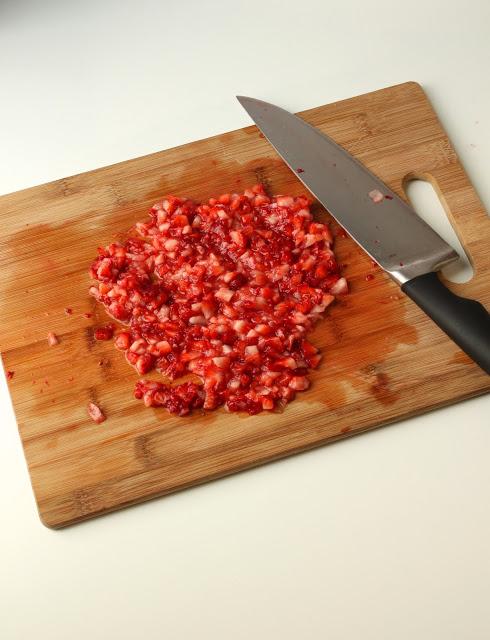 finely chopped fresh strawberries on a cutting board