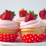 platter of strawberry cupcakes with strawberry buttercream frosting