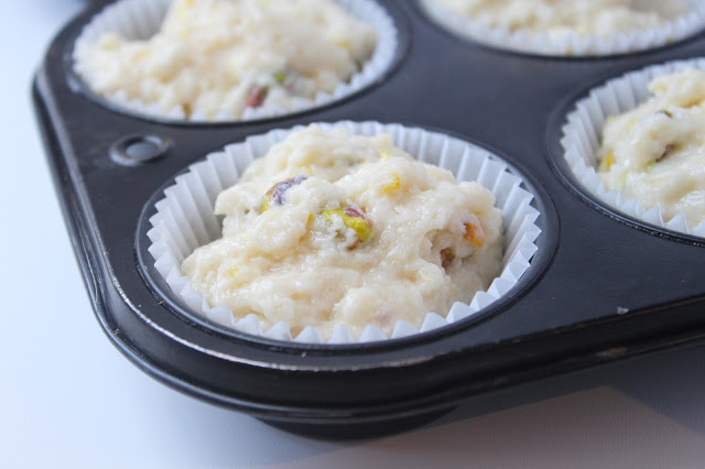 unbaked pistachio muffins batter in a muffin pan
