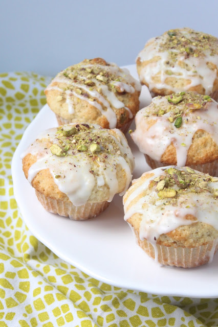 platter of pistachio muffins with lemon glaze