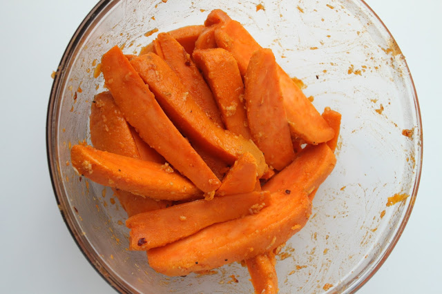 boiled sweet potato wedges tossed with seasoning