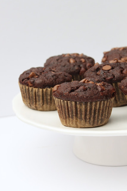 These healthier Double Chocolate Zucchini Muffins are packed with veggies and they're a more wholesome way to satisfy your chocolate cravings! Recipe from thebusybaker.ca!