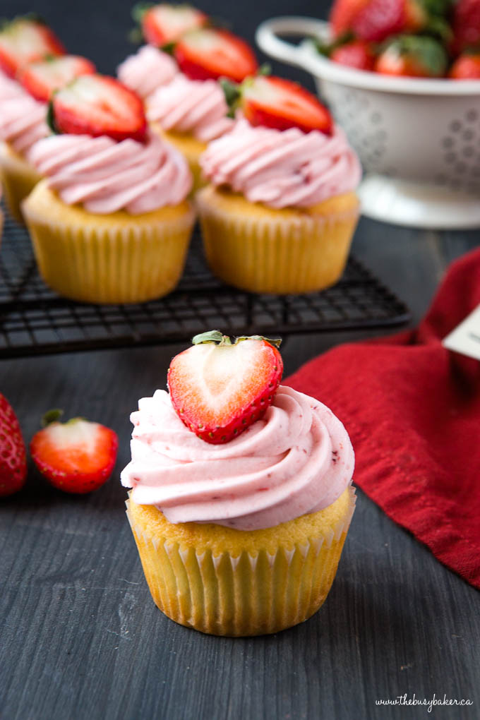strawberry cupcake with a fresh strawberry on top