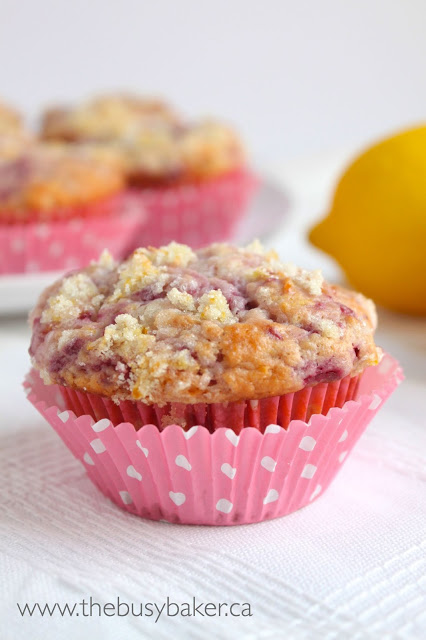 a fluffy homemade muffin with fresh raspberries