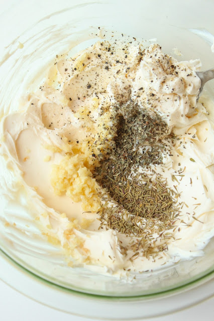 mixing bowl with ingredients to make cream cheese spread for a crostini recipe