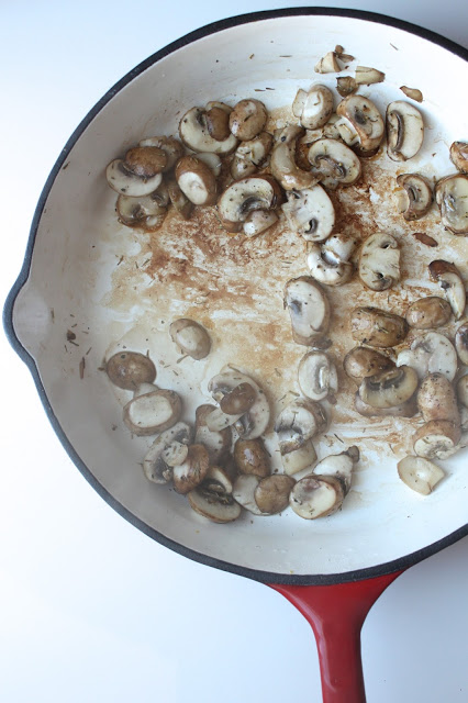 sauteeing fresh mushrooms in a skillet