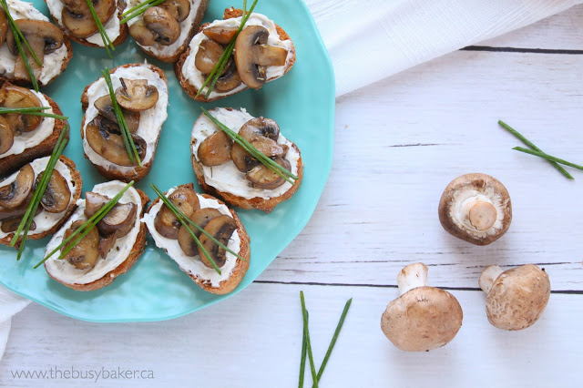 fresh mushrooms and herbs on slices of baguette