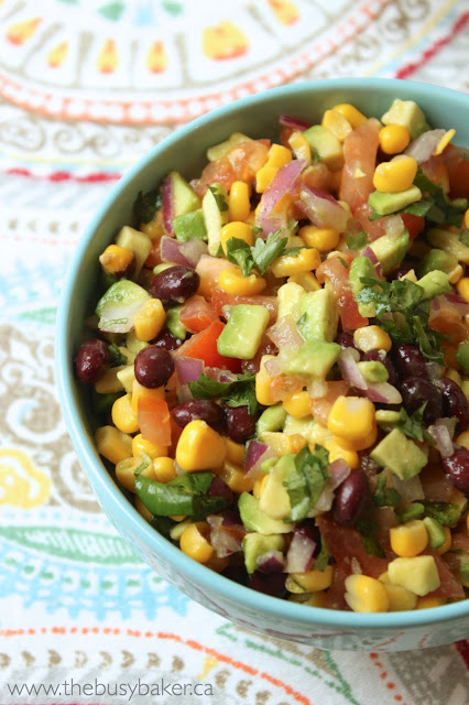 bowl of fresh Mexican salsa with black beans, corn, and avocado