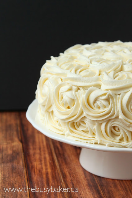 homemade birthday cake topped with vanilla bean buttercream frosting roses