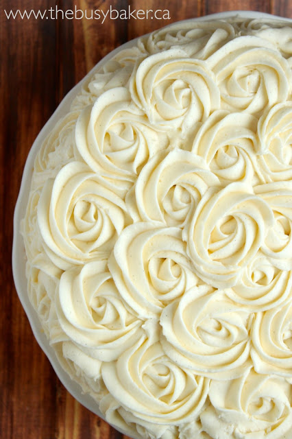 vanilla bean birthday cake decorated with roses made out of frosting