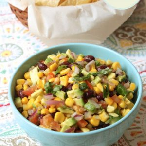 bowl of black bean salsa with corn and avocado