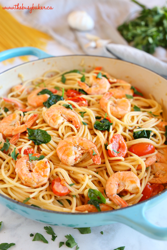 This Easy Healthy Shrimp Scampi is a delicious and healthy weeknight meat featuring fresh shrimp, pasta and veggies in a light-tasting garlic cream sauce! Recipe from thebusybaker.ca! #shrimpscampi #easyshrimppasta #healthyshrimppasta #healthyshrimpscampi