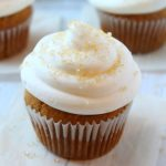 pumpkin spice cupcakes topped with cream cheese frosting