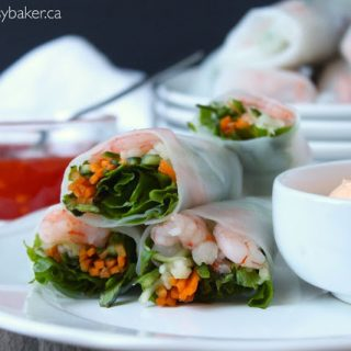 shrimp and vegetable spring rolls with a side of creamy sriracha dipping sauce