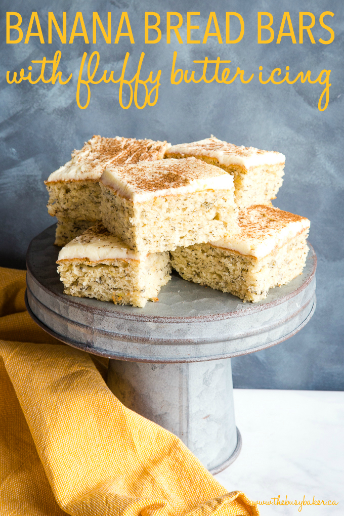 Banana Bread Bars with Fluffy Butter Icing on galvanized cake stand