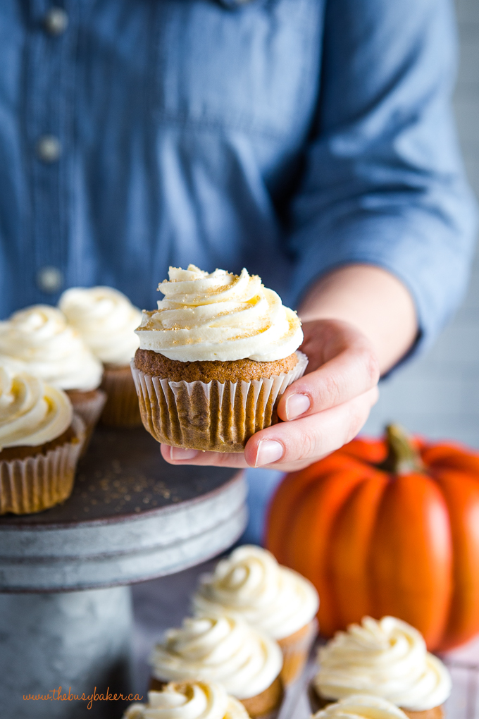 pumpkin spice cupcake in hand