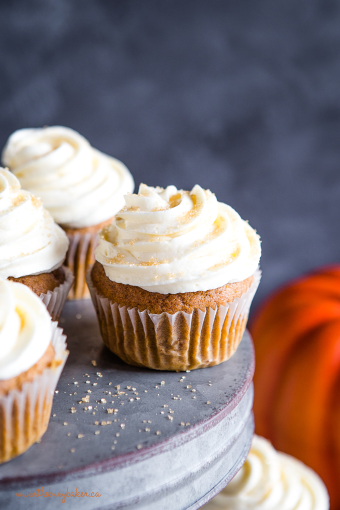 Pumpkin spice cupcakes on galvanized metal cake stand