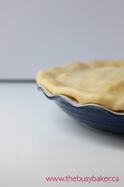 crimping pastry crust into a pie pan