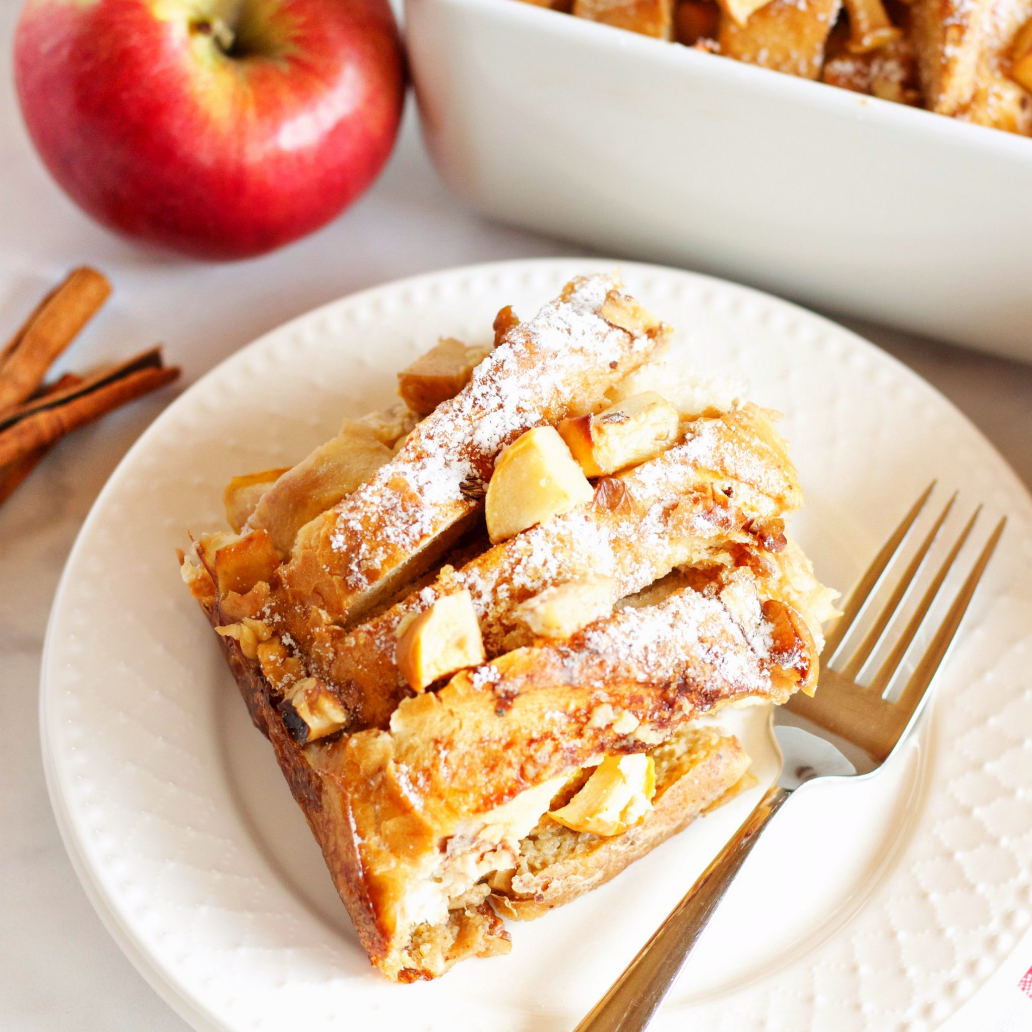 Apple Cinnamon French Toast Cerole - The Busy Baker on apple gardening, apple recipe ideas, apple curtains, apple table centerpieces, apple thanksgiving, apple pull knobs for kitchens, apple diy, apple green bedroom ideas, apple food ideas, apple painting ideas, apple lunch ideas, apple stained glass lamp, apple furniture, apple gift ideas, apple decorating ideas, apple art ideas, apple breakfast ideas, apple decoration ideas, apple wedding ideas,