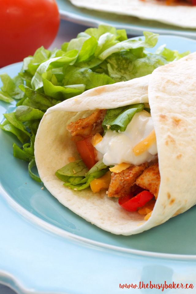 These Easy Oven Baked Chicken Fajitas are the perfect quick and easy weeknight meal! Recipe from www.thebusybaker.ca