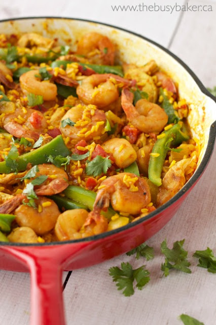 Easy Paella Recipe cooking in a cast iron skillet