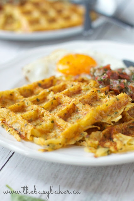 waffle iron hash browns on a plate with fried eggs