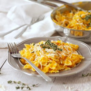 plate of butternut squash pasta sauce served over bow tie pasta.