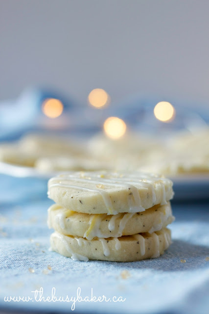 3 buttery lemon shortbread cookies stacked on top of one another